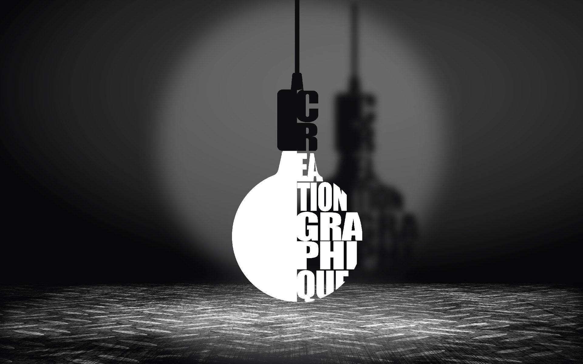 """Illustration : une ampoule allumée est constituée des mots """"Création graphique"""""""